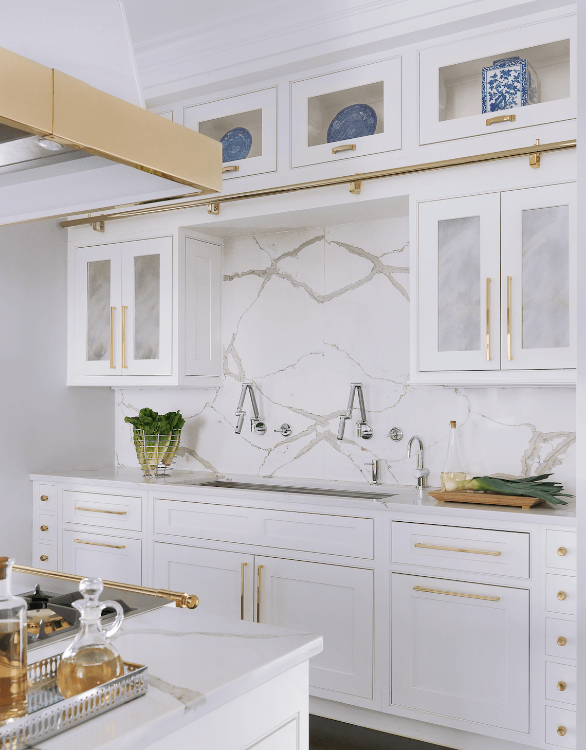Traditional Kitchen in White and Brass