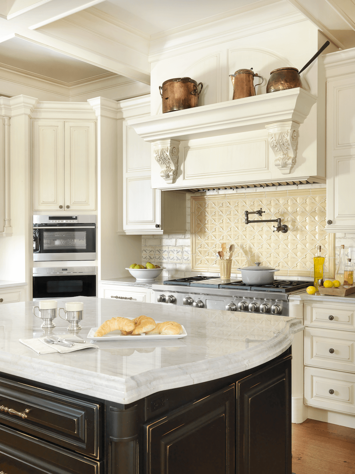 A Cook's Kitchen - Traditional Range Hood with Double Ovens by Beck/Allen Cabinetry